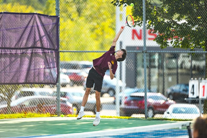 Bloomington North's Casey McIntyre serves the ball during his No. 2 doubles match against Bloomington South during the 2020 season.