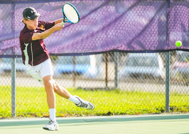 Bloomington North's Connor O'Guinn returns the ball during his No. 2 doubles match during the Bloomington North-Bloomington South tennis match at South Thursday evening. (Bobby Goddin/Herald-Times)