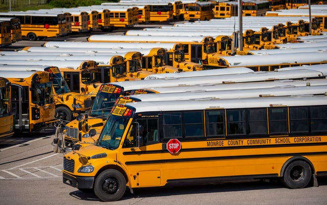 Some of the district's buses are parked at the Monroe County Community School Corp.'s transit parking lot in June 2020.