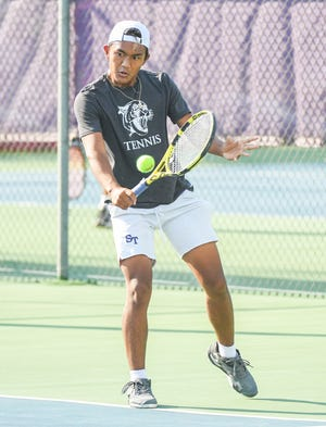 Bloomington South's Chris Lian returns the ball during his No. 2 singles match against Bloomington North's Nate Abdullah during the Bloomington North-Bloomington South tennis match at South Thursday evening. (Bobby Goddin/Herald-Times)