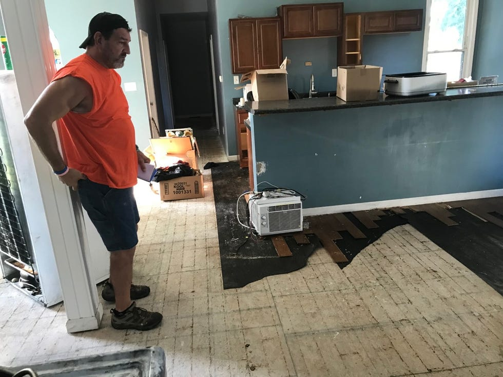 Terry Ramer looks over a water-damaged floor and subfloor at one of the rental homes he owns on the East Bluff on Wednesday, Sept. 8, 2021. In late August, a vandal ransacked the place, causing about $60,000 in damage, Ramer says.