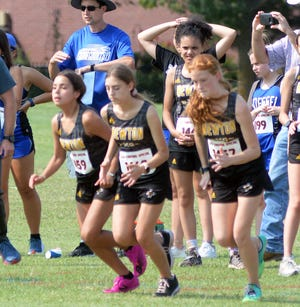 The Newton High School freshmen girls leave the starting line at the Swather Special.