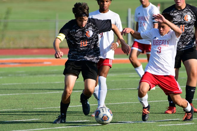 Kirksville's Patrick Jennings battles with Moberly's Ryan O'Laughlin for possession during a boys soccer game on Thursday at Spainhower Field.