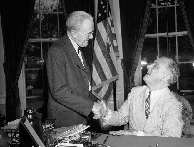 Sen. George W. Norris of Nebraska meets President Franklin Roosevelt on July 11, 1941.