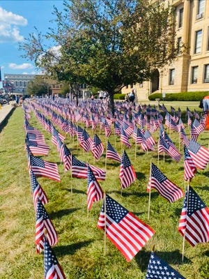 Courier reader Marsha Fernandez shared this photo that pays tribute to the memory of those Americans who lost their lives on Sept. 11, 2001.  2,977 American flags were placed on the grounds of the Logan County Courthouse earlier in the week to observe the 20th anniversary of that day in American history.