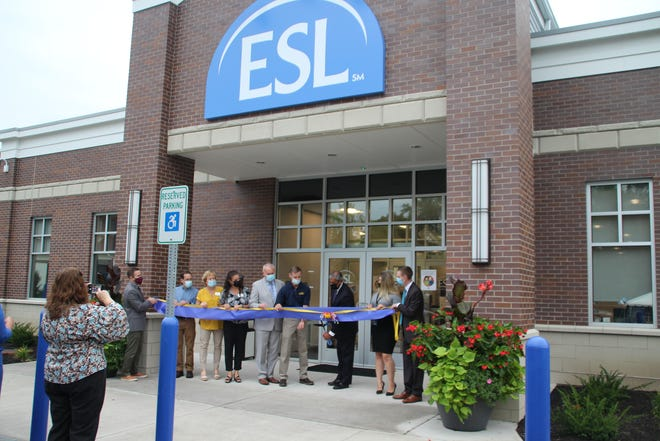 ESL Federal Credit Union celebrates the opening of its 23rd branch at 32 School St., its second in the Victor community. Pictured, from left, are Victor Farmington Library director Tim Niver; Victor Economic Development director Kathy Rayburn; Amy DiPrima, executive director of the Victor Chamber of Commerce; Town Supervisor Jack Marren; Village Mayor Gary Hadden; Faheem Masood, ESL president and CEO; and branch manager Lindsey Tambe.