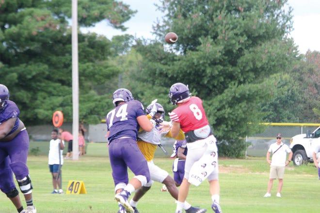 Connor Sampson throws a pass.