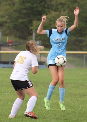 Frankfort's Ella Booth stops the ball mid-air with her body against Keyser on Thursday.