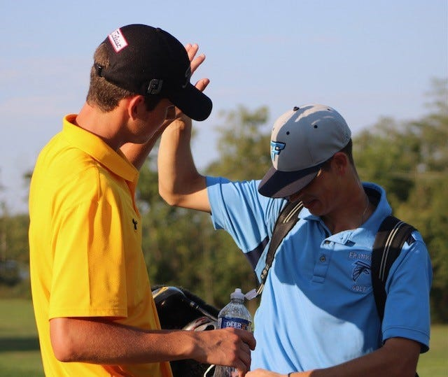 Keyser's Drew Matlick and Frankfort's Bryson Lane high-five each other after a recent match at Polish Pines.