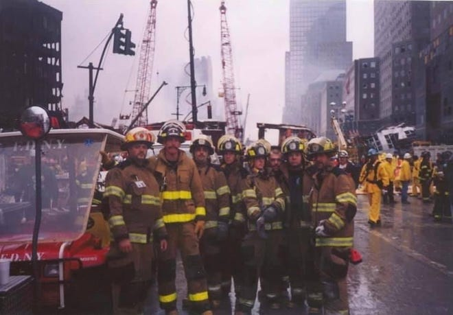 Firefighters from Monroe County are pictured at the site of Ground Zero. Several from the area made their way to New York City in the days following 9/11 to aid in recovery efforts.