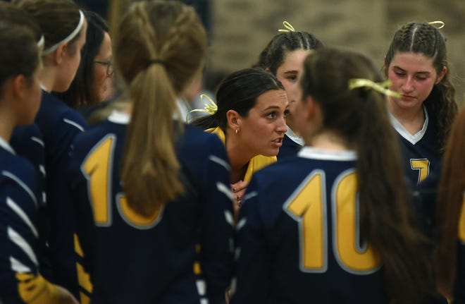 Whiteford volleyball coach Janie Bunge talks to her team during a match earlier this season.