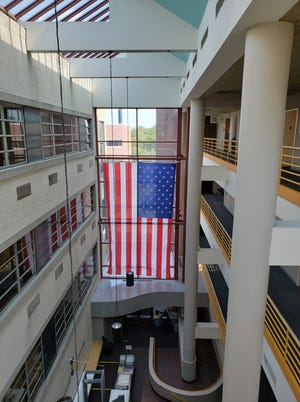 The new Stars and Stripes hangs inside the Monroe County Courthouse.