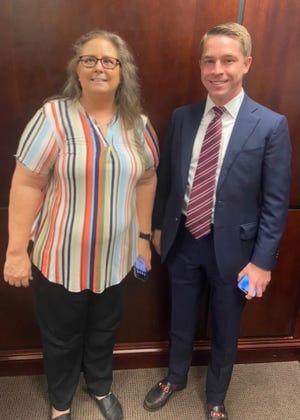 Angie Leddon, Walton County Grants coordinator, poses for a photo with Andrew Nixon, Florida DEO press secretary.
