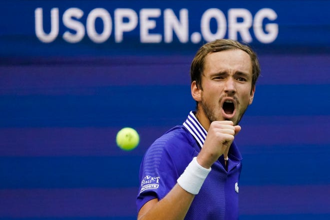 Daniil Medvedev, of Russia, reacts after scoring a point against Felix Auger-Aliassime, of Canada, during his victory in the semifinals of the US Open tennis championships on Friday in New York. [AP Photo/Seth Wenig]