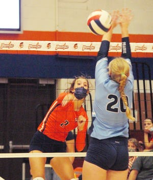 Pontiac sophomore Bailey Masching drives an attack past Prairie Central defender Lillie Hogan during the Indians' two-seet volleyball win Thursday at PTHS. Masching had 6 kills in the match.