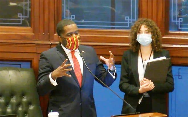 Rep. Marcus Evans, D-Chicago, introduces Senate Bill 2408 on the House floor Thursday evening.