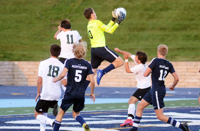 Petoskey keeper Jackson Jonker (middle) elevates to grab the ball in the Northmen box on a Traverse City West corner kick during the Big North Conference opener Thursday.