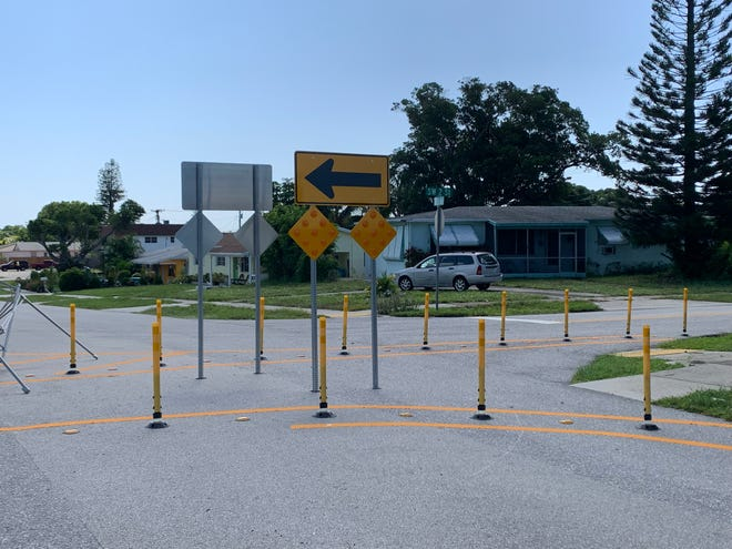Traffic dividers at the this intersection in Boynton Beach's Forest Park neighborhood slow down motorists by forcing them to make left or right turns instead of continuing straight.