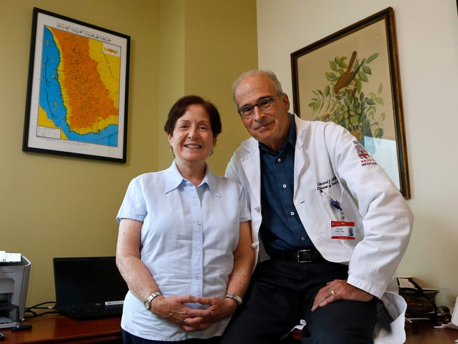 Anne and Ed Stulik, at his office at Brown Medicine in East Providence. Ed is a primary care doctor at Brown Medicine and Anne is a nurse practitioner at Women & Infants Hospital. Because of his Peace Corps experiences in Yemen with Anne, Ed decided to go to medical school.  On the wall is a map of Yemen.