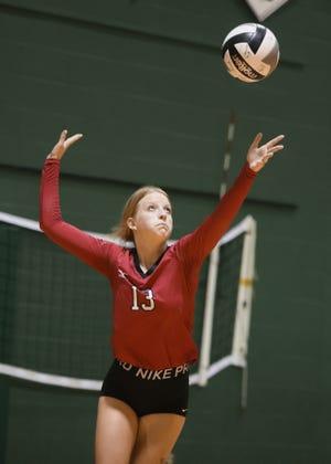 Kent Roosevelt junior Olivia Sams tosses up a serve during Thursday night's game at Aurora High School.
