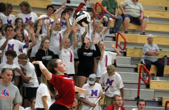 Martinsville junior Molly Urban serves in front a good student section during Thursday's home game against Roncalli.