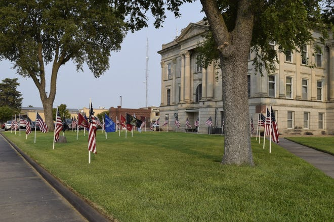 Around 30 American and military service branch flags were placed on the south lawn of the Senior Center Friday morning. The center honored veterans during an event on the eve of the 20th anniversary of 9/11.