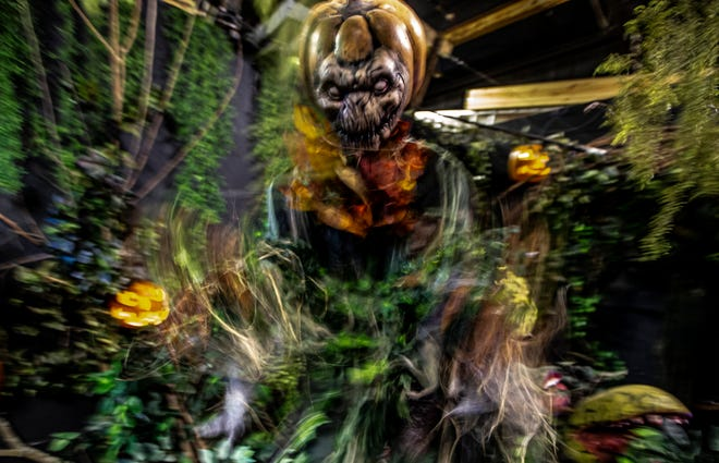 A pumpkin-headed creature leaps out at the Niles Scream Park, whichopens Sept. 10 and continues weekends through Nov. 6.