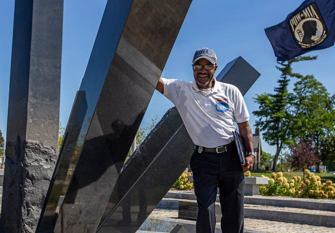 Darryl McKinney stands next to the Veteran's Memorial at Howard Park on Friday, Sept. 10, 2021, in South Bend.