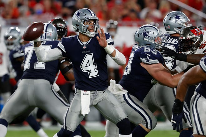 Dallas Cowboys quarterback Dak Prescott (4) throws a pass against the Tampa Bay Buccaneers during the first on Thursday in Tampa, Fla.