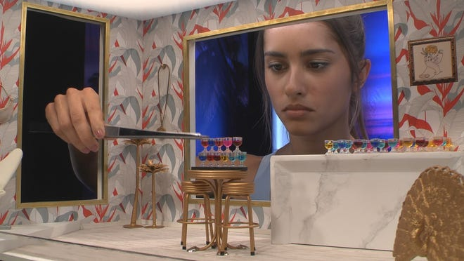 """Alyssa Lopez maneuvers tiny drink glasses to win a competition to temporarily save her place in the """"Big Brother"""" house before she was eliminated by a loyal six-person alliance Thursday night."""