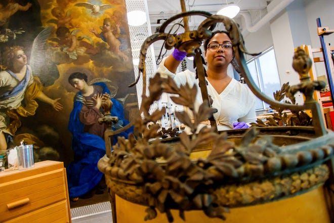 A New College student gains experience as an intern in the Conservation Lab, restoring art at the Ringing Museum of Art.