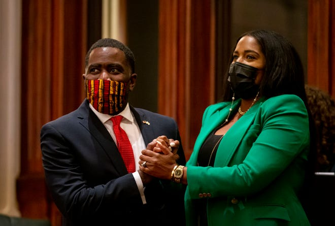 Illinois state Rep. Marcus Evans, Jr., left, D-Chicago, celebrates Thursday with Illinois State Rep. Jehan Gordon-Booth, D-Peoria, as Senate Bill 2048, a comprehensive energy proposal, passes the Illinois House of Representatives at the state Capitol. [Justin L. Fowler/The State Journal-Register]