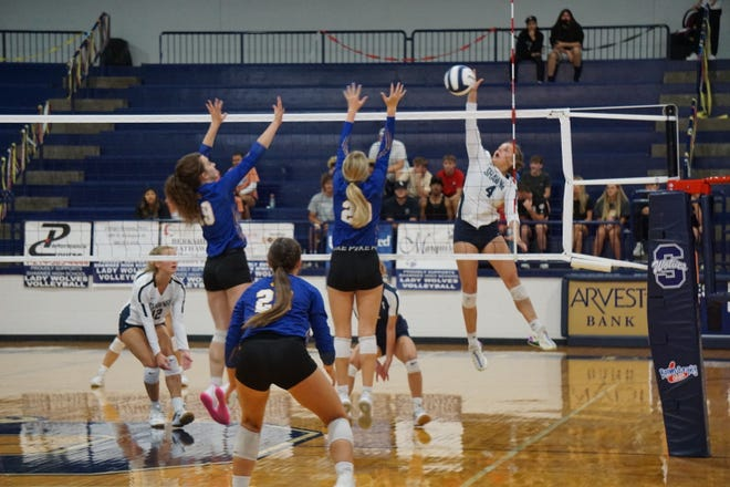 Senior Madison Crowell (4) goes up for a kill against Piedmont in Thursday nights game.
