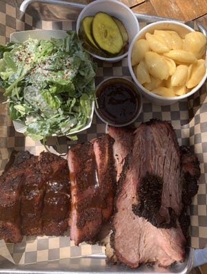"""Etna Brewing Co.'s  """"two meat two sides"""" plate with ribs with rye whiskey wash and house made root beer brisket, and side of pimento mac n cheese, Caesar salad with bread n butter pickles."""