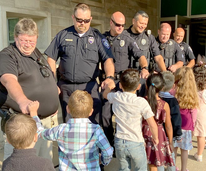 Students at Wall Elementary School in Sturgis greet first-responders at a ceremony Friday commemorating the 20th anniversary of the 9/11 attacks.