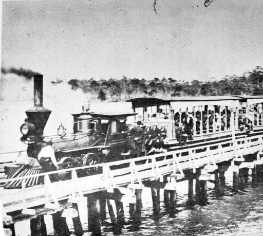 Captain John Harper's steamboats from Wilmington docked at Doctor's Point on the Cape Fear River where passengers boarded the Shoe-Fly Train for the ride across the peninsula to the ocean beach strand at the Carolina Beach Resort (1895-1920s).