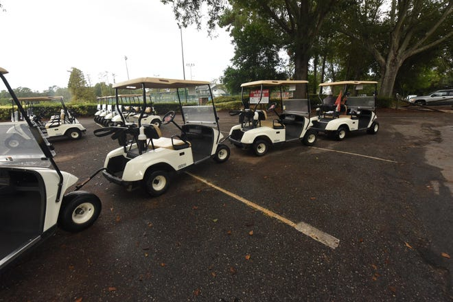 Golf carts are put in place for the day on Wednesday Oct. 11, 2017 at Echo Farms Golf & Country Club in Wilmington.