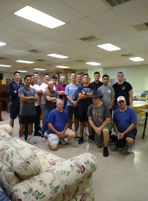 Marines volunteer their time to help with the Knights of Columbus fundraiser