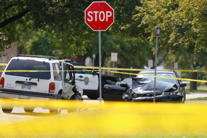 Two vehicles are wrecked at the intersection of S.W. Polk Ave. and S.W. 8th St. Friday afternoon at a crime scene of the 700 block of Polk.