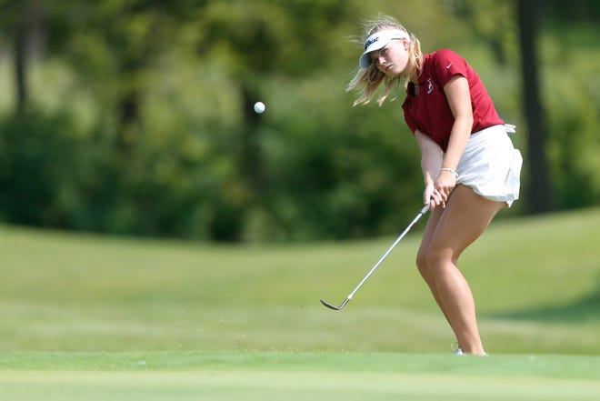 Seaman's Lois Deeter chips on to the green of hole 12 at Village Greens during the Seaman Girls Golf Invitational Thursday afternoon.
