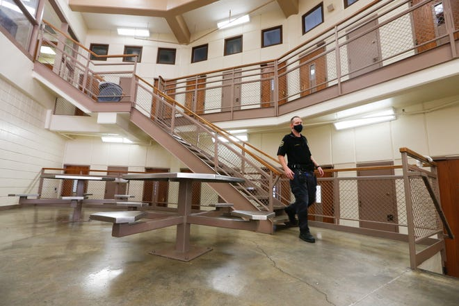 Shawnee County corrections officer Andrew Towle makes his routine round check inside T-Module at the correctional facility Thursday morning.