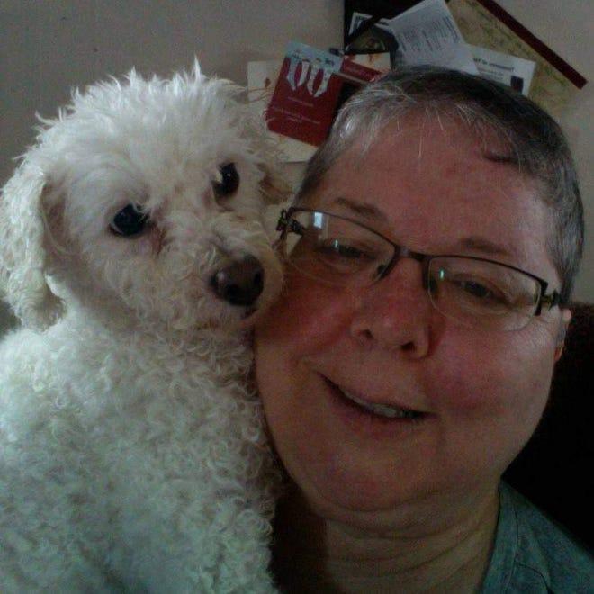 Stephanie Harris hugs her rescue poodle, Shirley.