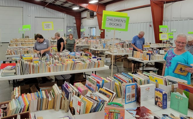 Shoppers look at their options Friday during the Friends of the Watertown Regional Library used book sale. The event continues through Sunday.