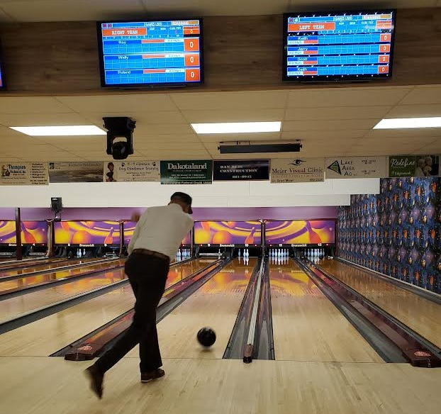 Roland Kleinschmidt, 91, rolls a ball Friday at Tommy's Lanes during the South Dakota Senior Games.
