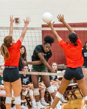 Waxahachie senior Jh'Kyah Head goes strong for the kill in a preseason scrimmage at Red Oak. The Lady Indians traveled to Keller Timber Creek on Tuesday and came away with a four-set non-district loss.