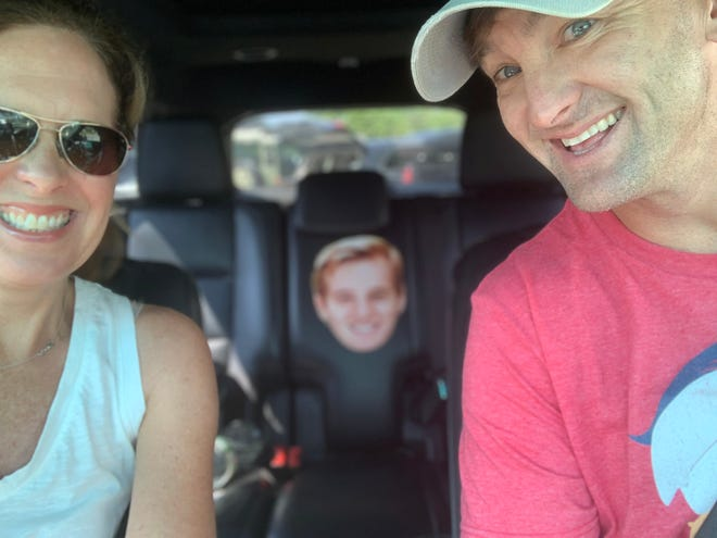 Pictured: Sami Greenfield, with her husband Todd Greenfield and their son Tyler Greenfield.