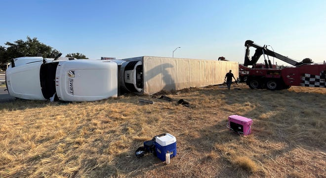 A semi pulling a trailer overturned Thursday at the South First exit from the northbound lane of the Winters Freeway. The exit ramp was closed to traffic by police. The driver was not injured.