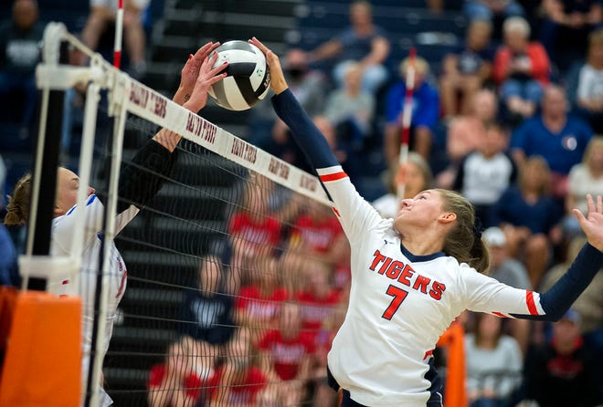 Galion's Kalyn Carroll attempts to hit the ball past a Highland defender.