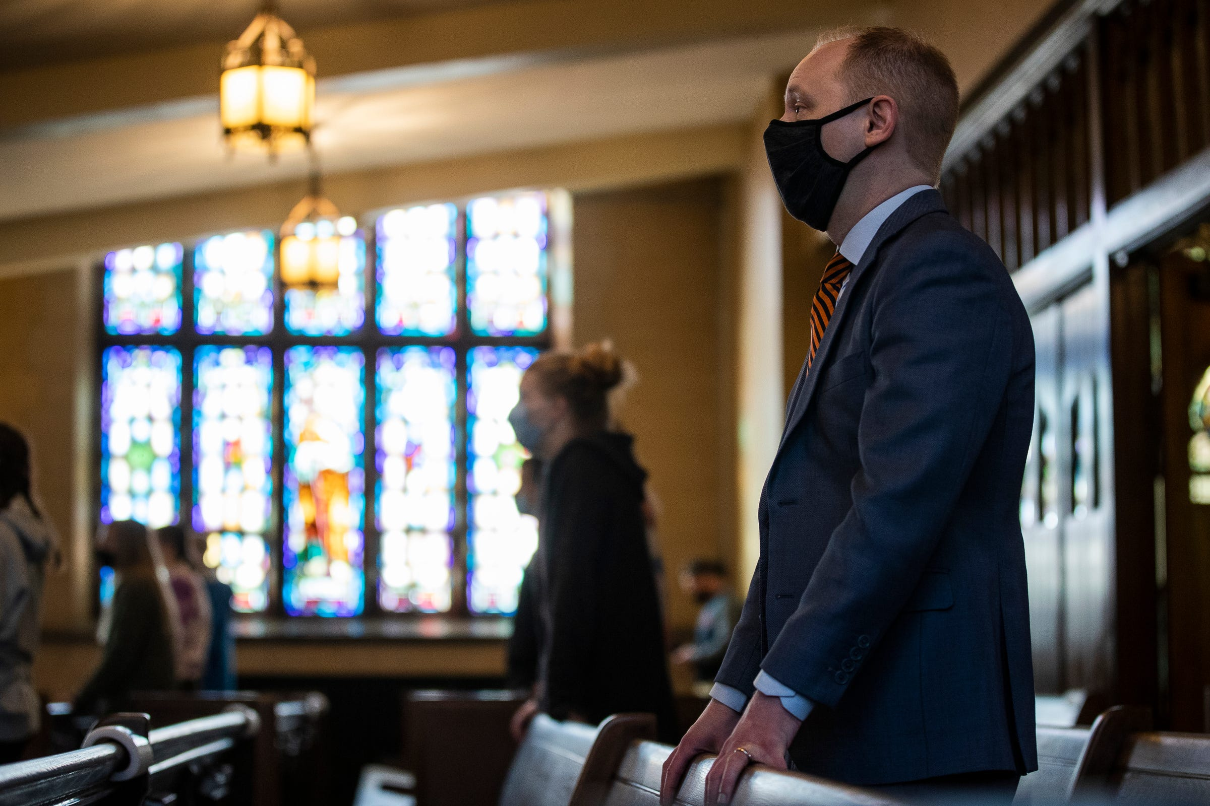 Hope College president Matthew Scogin attends a worship service at the Dimnent Memorial Chapel on campus in Holland, Wednesday, March 31, 2021.
