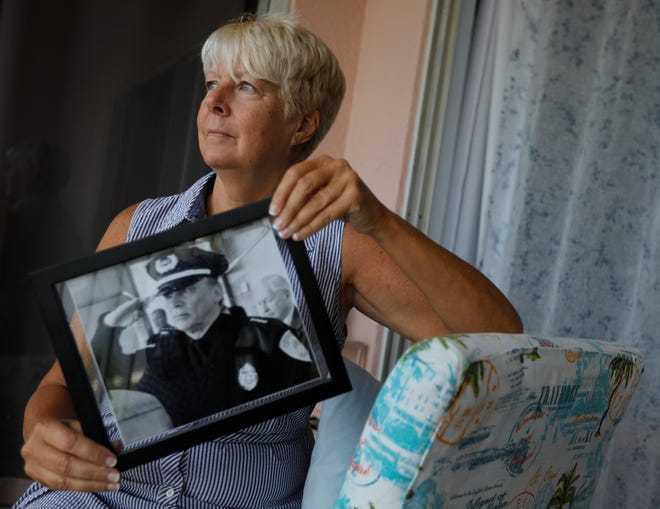 Cape Coral resident Cheryle Rumble displays a photo of her late husband, retired Chief Rodney Rumble of the Weymouth PD.